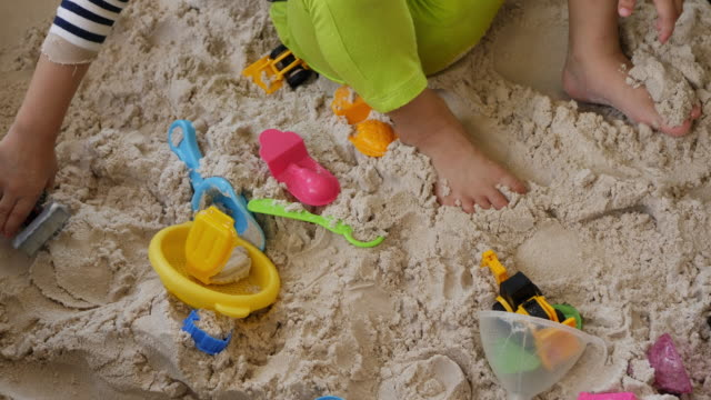 kids playing toy on sand beach - 2 kid in a sandbox stock videos and b-roll footage