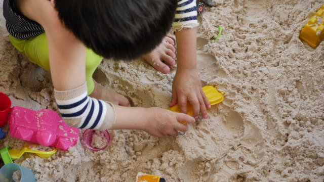 kids playing toy on sand playground - 2 kid in a sandbox stock videos and b-roll footage
