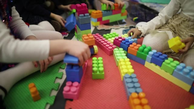kids playing with building blocks - block shape stock videos & royalty-free footage