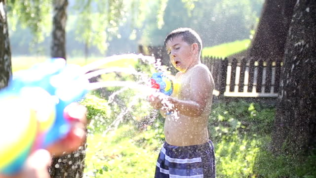 kids playing with water gun - water fight stock videos & royalty-free footage