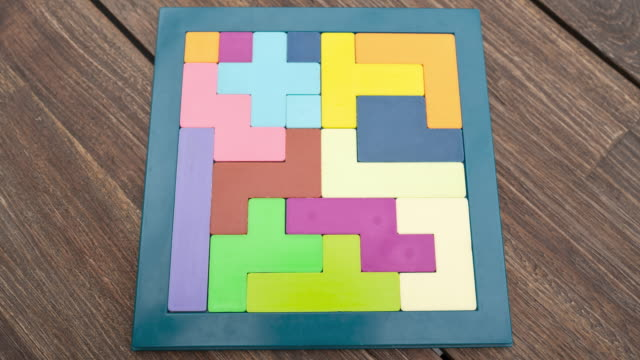 vídeos y material grabado en eventos de stock de kids puzzle being put together - puzzle