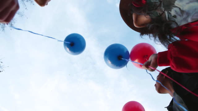 ms kids releasing balloons in air / los angeles, california, united states  - releasing stock videos and b-roll footage