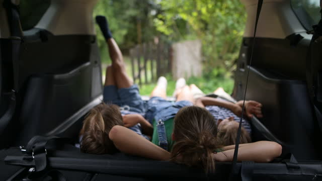 kids resting in car interior - lying on back stock videos & royalty-free footage