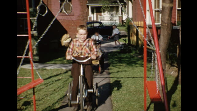 1952 home movie kids riding tricycles in backyard / toronto, canada - 2 3 år bildbanksvideor och videomaterial från bakom kulisserna
