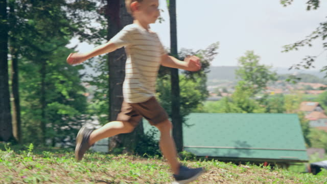 slo mo ts kids running down a sunny hill on a nice summer day - three people stock videos & royalty-free footage