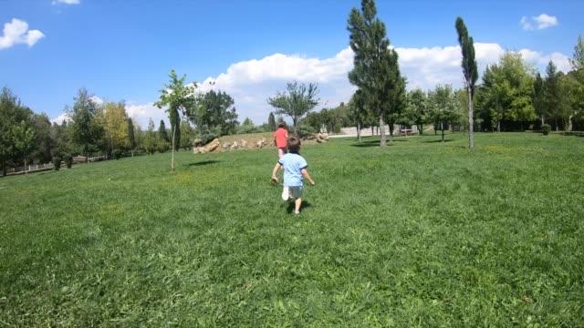Kids running over a field