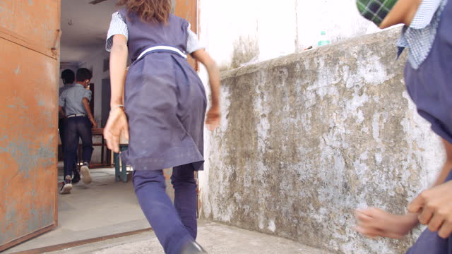 kids running up a staircase and open the door of classroom and enter it - india stock videos & royalty-free footage