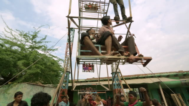 a kids self-operated ferris wheel in india - uttar pradesh stock videos and b-roll footage