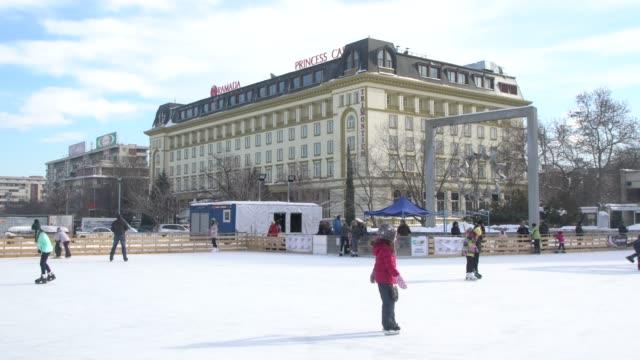 kids skating on an ice rink in plovdiv, bulgaria - pavel gospodinov stock videos & royalty-free footage