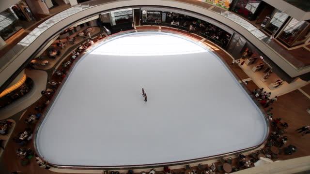 ws kids skating on  indoor skating rink / singapore,singapore, singapore - ice rink stock videos & royalty-free footage