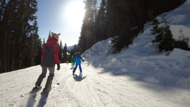 kids skiing in the alps - ski holiday stock videos & royalty-free footage