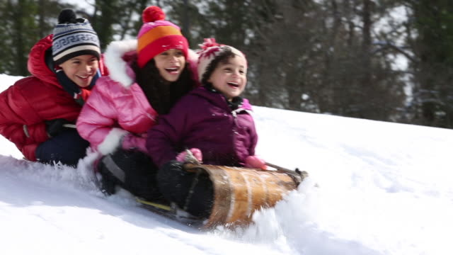 kids sledding on snowy hill - sledge stock videos & royalty-free footage