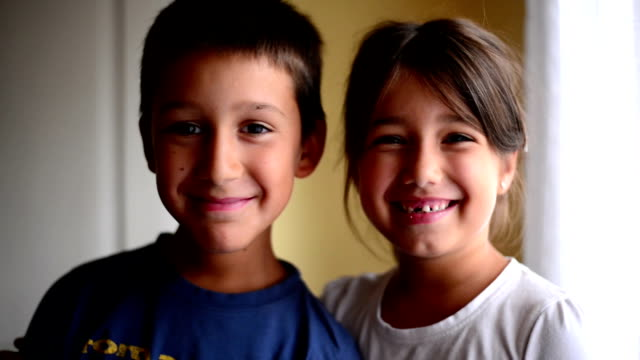 kids smilling - sibling stock videos and b-roll footage