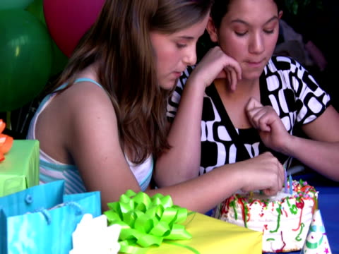 kids sneaking cake at birthday party - only girls stock videos and b-roll footage