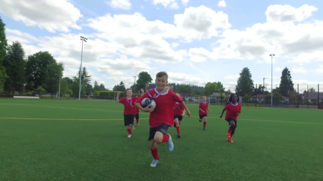 kids soccer team celebrating after soccer match - sports team stock videos & royalty-free footage