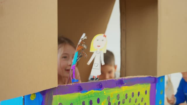 kids staging a puppet show - puppet stock videos & royalty-free footage