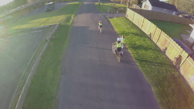 kids to school on bikes - reflective clothing stock videos & royalty-free footage