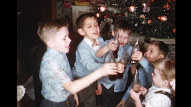 vídeos de stock e filmes b-roll de 1958 ms kids (8-13) toasting and drinking soda, toronto, ontario, canada - 1950