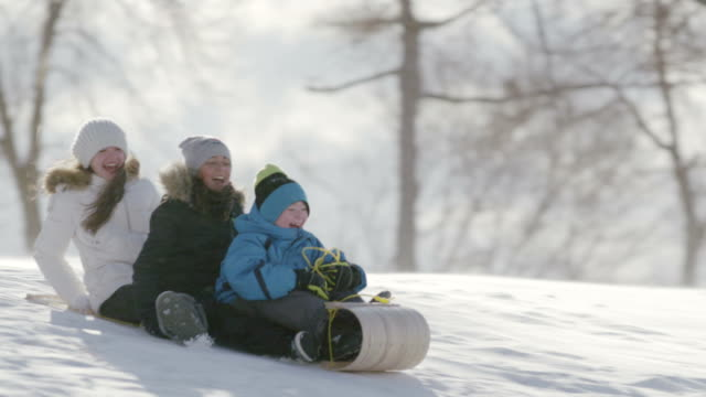 kids tobogganing - winter coat stock videos & royalty-free footage