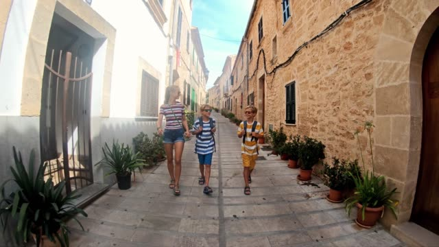 kids tourists visiting spanish mediterranean town - narrow stock videos & royalty-free footage