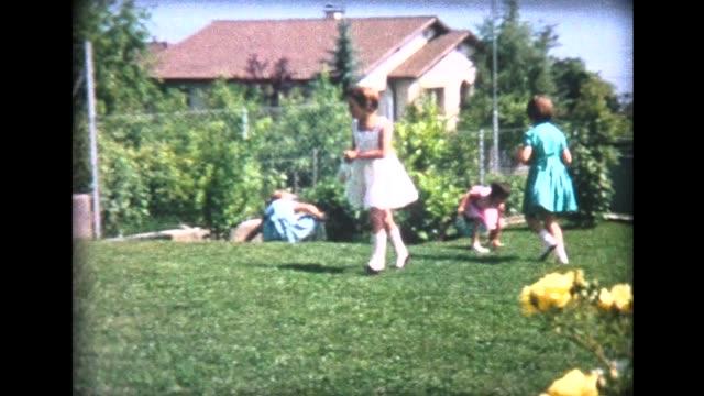 1964 kids treasure hunt in swiss garden - 宝探し点の映像素材/bロール