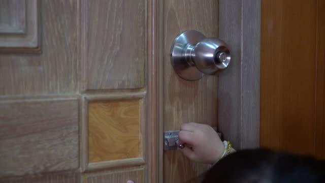 Kids try to open the door.