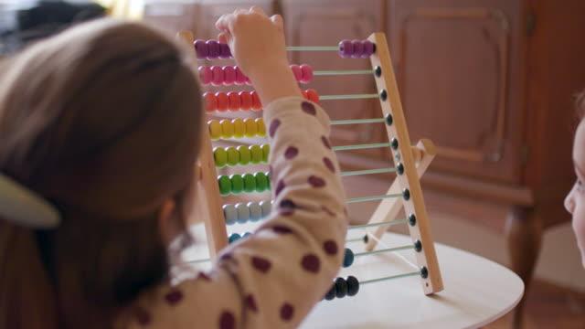 Kids using abacus