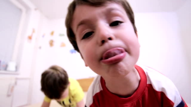 kids - sticking out tongue stock videos & royalty-free footage