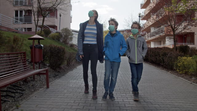 kids walking in residential district during covid-19 pandemic - pavement stock videos & royalty-free footage