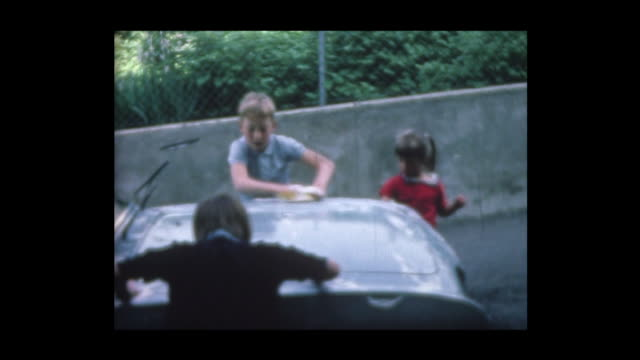1967 kids wash dad's old ford - car wash stock videos & royalty-free footage