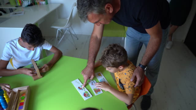 kids with learning difficulty playing with educational toys during occupational therapy at rehabilitation center - invisible disability stock videos & royalty-free footage