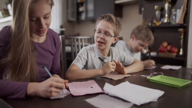 kids writing on the hand made recycled paper - paper mill stock videos & royalty-free footage