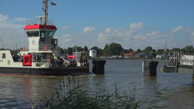 kiel canal ferries at brunsbüttel, diethmarschen, schleswig-holstein, germany - fähre stock-videos und b-roll-filmmaterial
