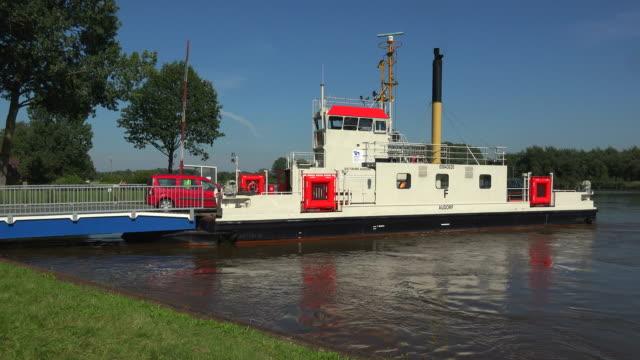 kiel canal ferry near burg, dithmarschen, schleswig-holstein, germany - fähre stock-videos und b-roll-filmmaterial