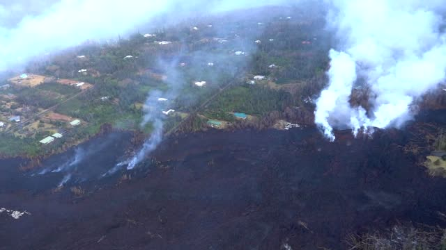kilauea lava flow aerial footage taken from a hawaii army national guard uh 60 helicopter pahoa hawaii may 9 2018 image courtesy tech sgt andrew... - kilauea stock videos & royalty-free footage