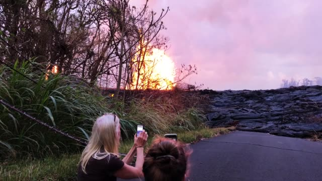kilauea volcano lava erupts from a fissure during ongoing eruptions in leilani estates on hawaii's big island on may 23 2018 in pahoa hawaii - kilauea stock videos & royalty-free footage