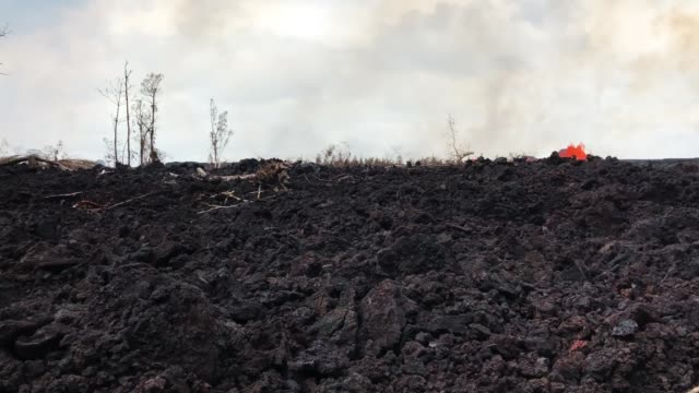 kilauea volcano lava erupts from a fissure during ongoing eruptions on hawaii's big island on may 26 2018 in pahoa hawaii - hawaii islands stock videos & royalty-free footage