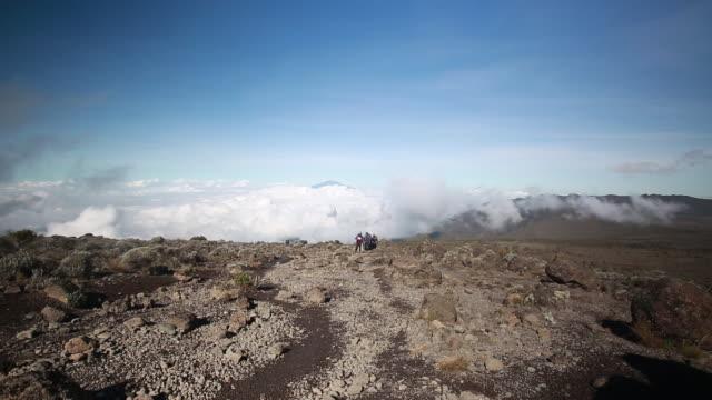 kilimanjaro climbing party walks toward camera - mt kilimanjaro stock videos & royalty-free footage
