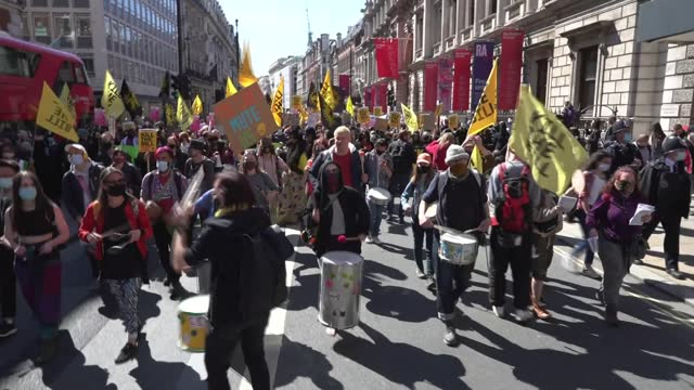 'kill the bill' protesters march through london; england: london: ext protesters marching along with placards and yellow 'kill the bill' banners.... - politics stock-videos und b-roll-filmmaterial