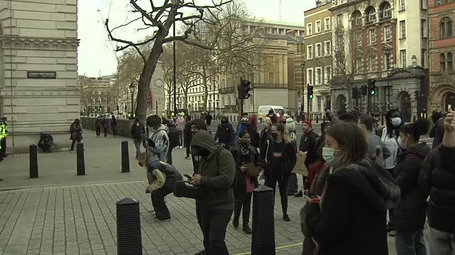 'kill the bill' protests: protesters and police clash in westminster; england: london: westminster: ext protesters marching along whitehall and... - war and conflict stock-videos und b-roll-filmmaterial
