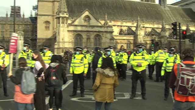 'kill the bill' protests: protesters and police clash in westminster; england: london: westminster: ext police in road in front of the houses of... - war and conflict stock-videos und b-roll-filmmaterial
