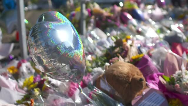 man appears in court charged with murder; england: derbyshire: killamarsh: ext floral tributes at makeshift memorial balloon - itv news at ten stock videos & royalty-free footage