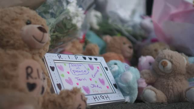 man appears in court charged with murder; england: derbyshire: killamarsh: ext blue police cordon tape pull focus makeshift memorial message by teddy... - rack focus stock videos & royalty-free footage