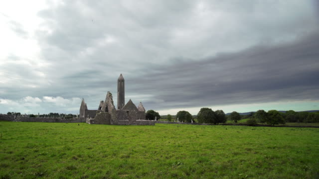t/l kilmacduagh monastery in county galway - old ruin stock videos and b-roll footage
