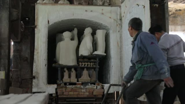 kiln is fired up inside a workshop that manufactures statues of former chinese leader mao zedong at the jingdezhen porcelain factory in jingdezhen,... - porcelain stock videos & royalty-free footage