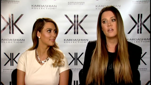 los angeles int kim kardashian and khloe kardashian interview on the launch of their clothing collection sot - 2013 bildbanksvideor och videomaterial från bakom kulisserna