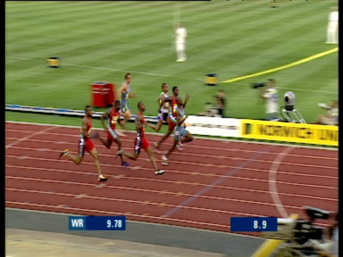 kim collins wins men's 100m heat 2, crystal palace grand prix 2003, london - track and field event stock videos & royalty-free footage