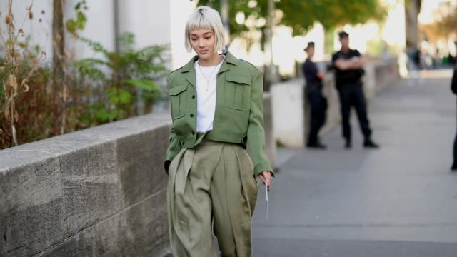 Kim Jones wearing olive green cropped jacket olive high waist pants is seen outside Sacai during Paris Fashion Week Womenswear Spring/Summer 2019 on...