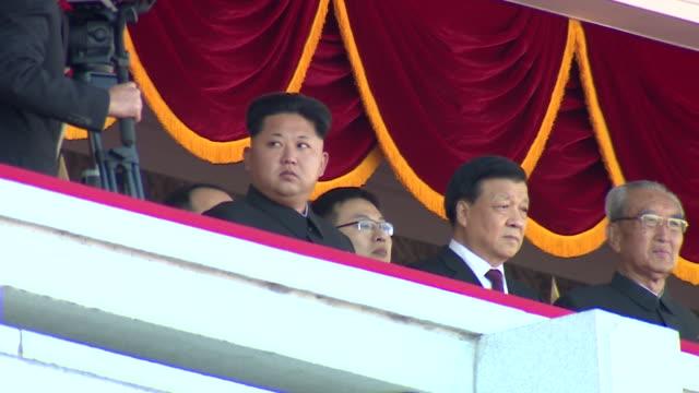 Kim JongUn and various dignitaries watch a military parade at Kim Ilsung Square Pyongyang
