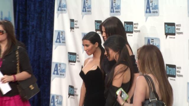 Kim Kardashian Khloe Kardashian Kourtney Kardashian at the Bravo's AList Awards at Los Angeles CA